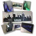 Laser-cut Black ABS plastic, LED edge-lit, intricate acrylic light guide